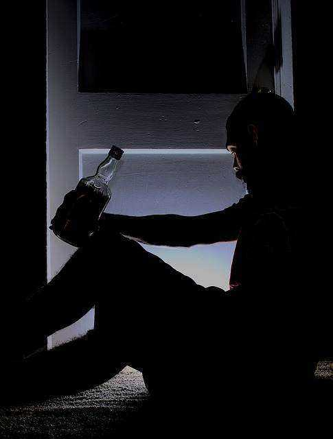 Man Drinking in Dark: DIY Family Law Australia